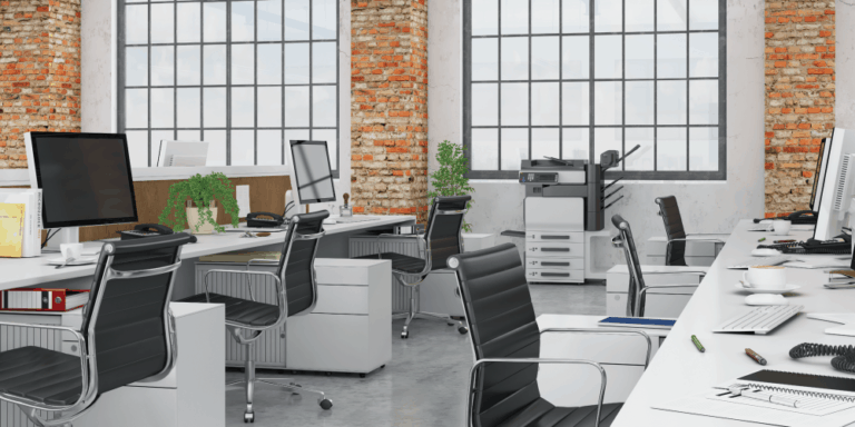 open office space with desks, chairs, and computers