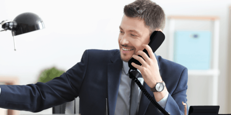 man in suit talking on telephone