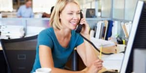 Office Worker Take a phone call using Sangoma's Unified Communications tools